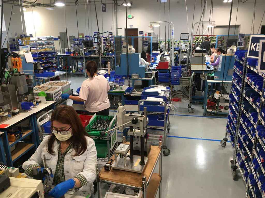 "Employees of Lin Engineering in Morgan Hill, pictured on the company's design floor April 9, have remained busy as ""essential"" workers throughout the coronavirus crisis."
